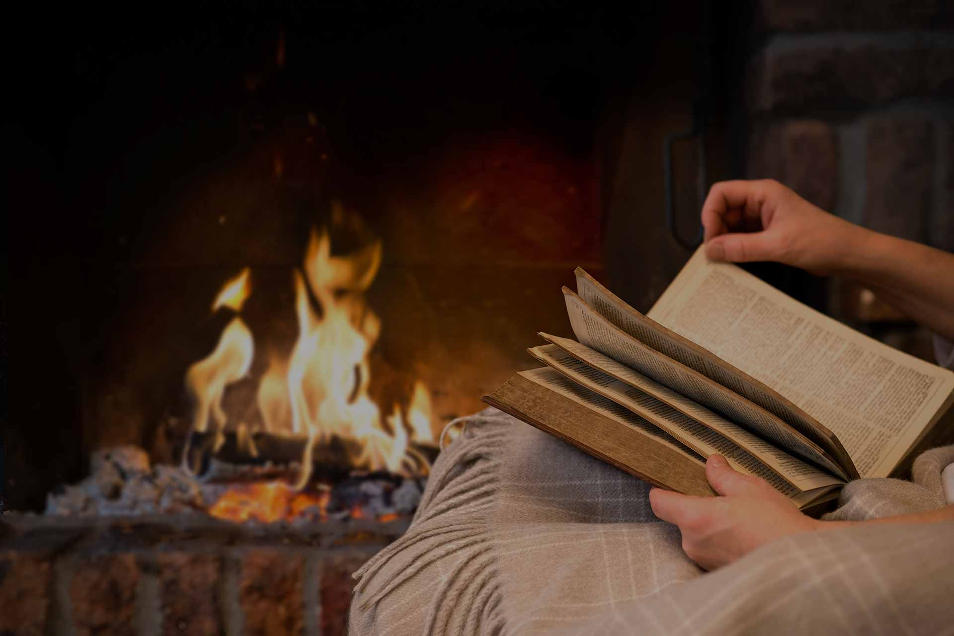 reading a book by a fire
