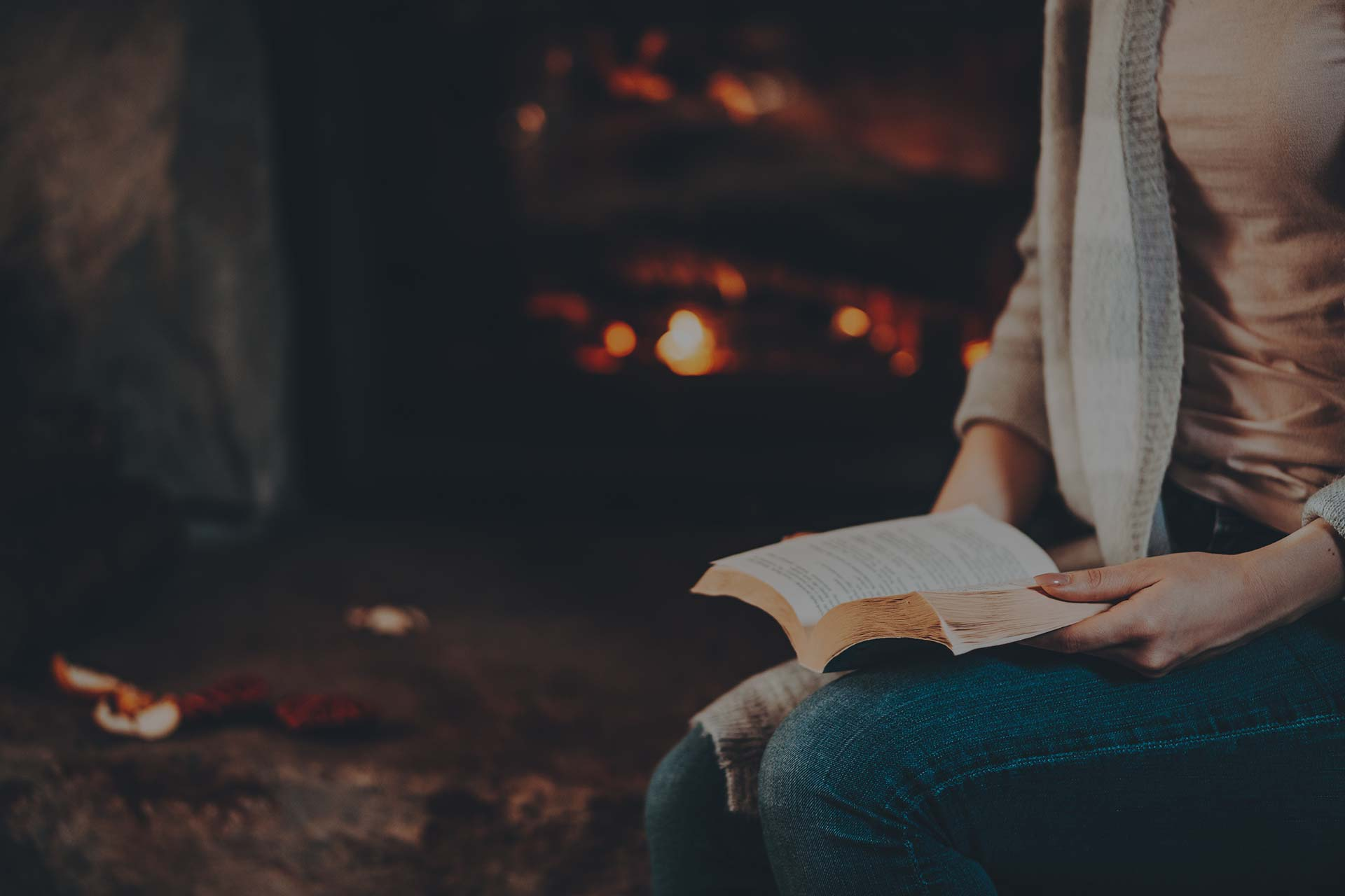 Reading by your homes fireplace